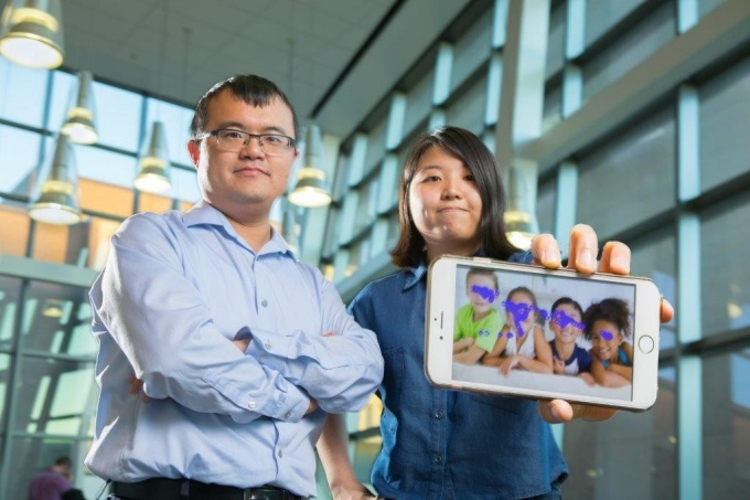 Wenyao Xu and Kun Woo Cho show a smartphone with the autism tracking software.