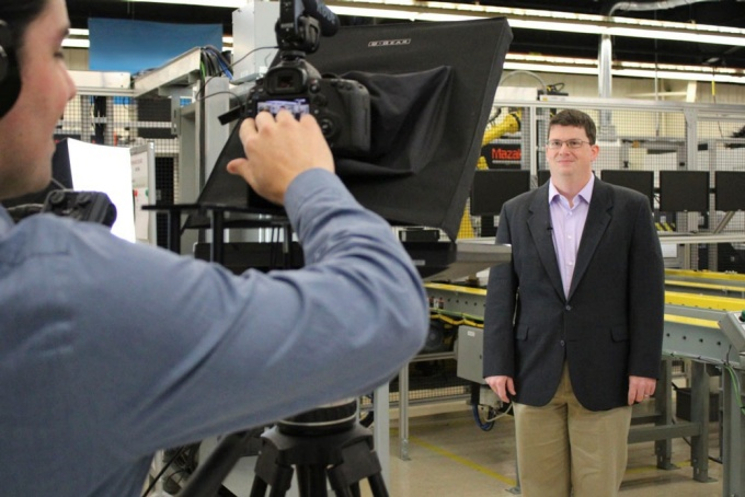 Kenneth English, films an introduction to one of the digital manufacturing and design courses. Behind the camera is J. Michael Vick.