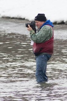 Ken Smith photographing at a Polar Plunge event