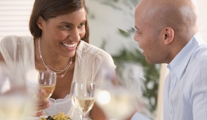Woman smiling and listening intently to her date