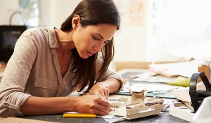 Female architect working on a model