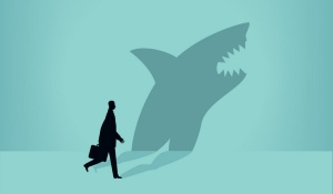 Illustration of a business person whose shadow is a shark