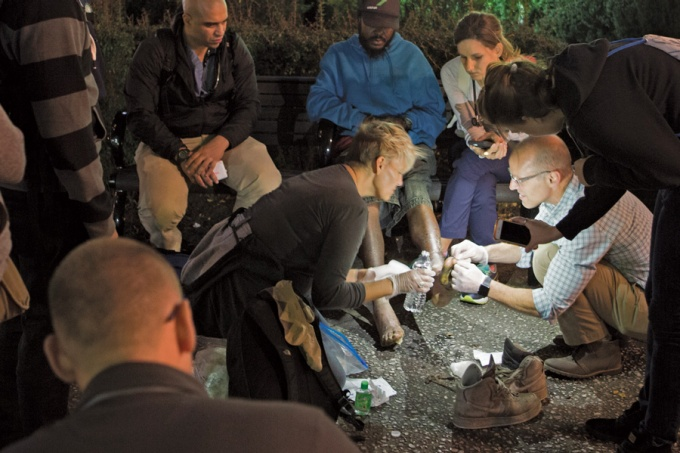 UB physician Christian DeFazio checks out a homeless man's feet.