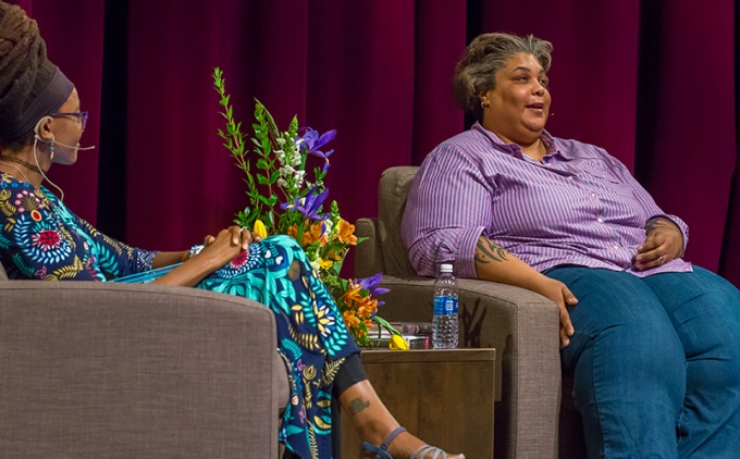 Roxane Gay and Nnedi Okorafor seated on the stage in the Center for the Arts Mainstage.