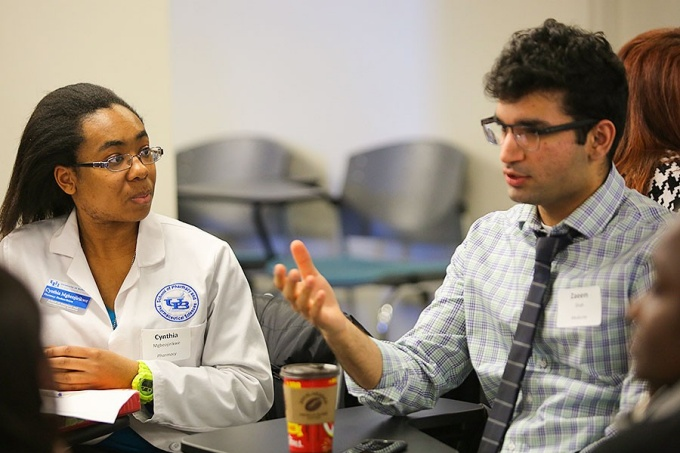Two students, Cynthia Mgbeojirikwe and Zaeem Shah, participate in the Interprofessional Education Forum.
