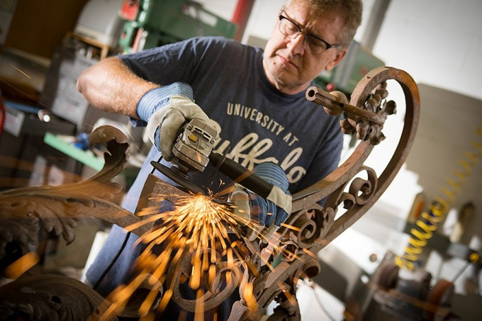 Brian Koyn grinds years of rust off the newly discovered lantern