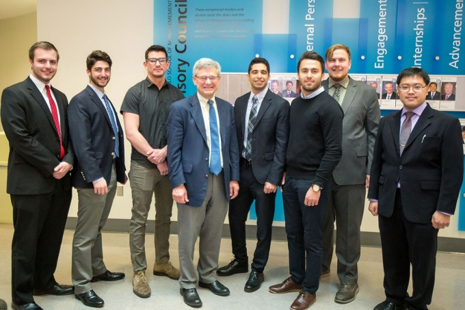 Winners of the Student Entrepreneur Fellowship Competition (eLab) stand with Provost Charles F. Zukoski in the Alfiero Center at the School of Management.