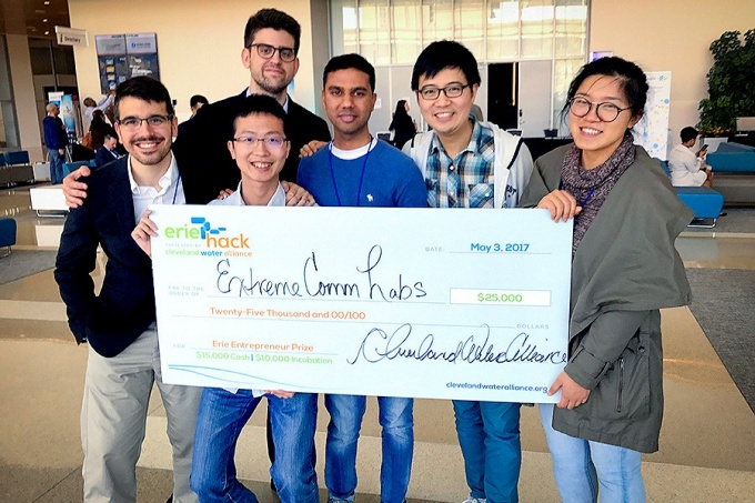 ExtremeComms Lab team with its Big check