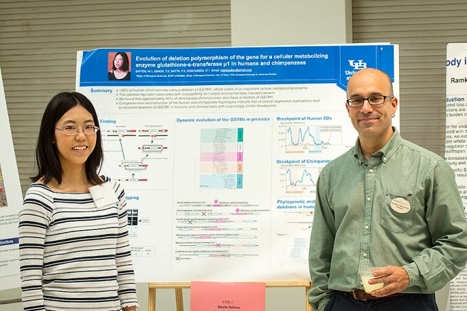 Postdoc Marie Saitou and her mentor, Omer Gokcumen, at Saitou's poster presentation in the Center for the Arts Atrium.