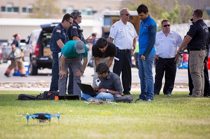(L-R) Souma Chowdhury, assistant professor of mechanical and aerospace engineering in the University at Buffalo's School of Engineering and Applied Sciences, together with ADAMS Lab research associates Sanchit Gupta, Arun Sunil and Maulik Kumar demonstrated how collaboration between autonomous drones can provide communications and other assistance to emergency responders.