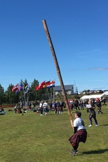 Karthryn Kendall participating in the caber toss