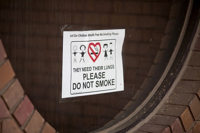 "A ""no smoking"" sign posted near the Early Childhood Research Center on the North Campus"