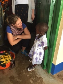 Alison Balind, then a UB MSW student from Canada, speaks with a local student during a trip to Tanzania in January 2016.