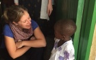 Alison Balind, then a UB MSW student from Canada, speaks with a local student during a trip to Tanzania in January 2016