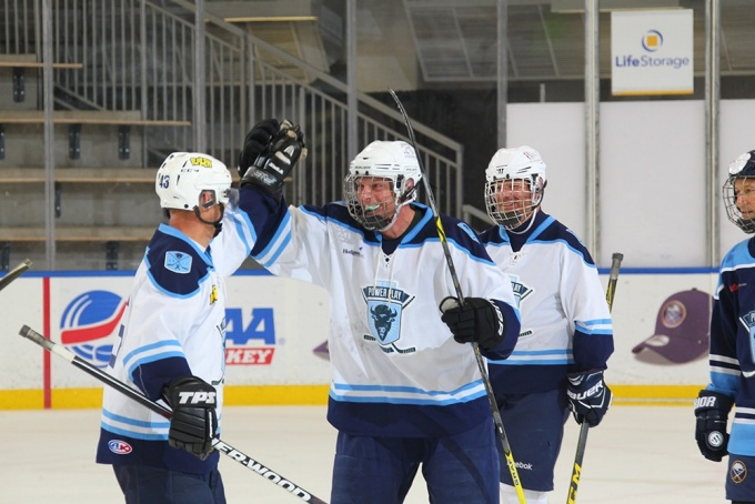 Peter Merlo (BS '93, MS '98) celebrates after scoring a goal in the world's longest hockey game.