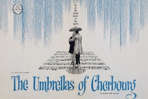 "Movie poster for ""The Umbrellas of Cherbourg,"" 1964, directed by Jacques Demy."