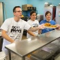 From left: Christopher Keough, Carmella Marinaccio and Jomarie Woltz serve meals at the City Mission.