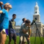 Students on the Hayes Hall lawn observe the August 21 eclipse