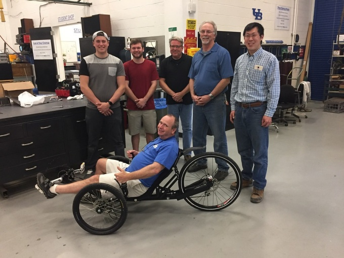 Curt Senf on his trike with UB students Caleb Walters and Austin Powers and Machine Shop staff William Macy, Gary Olson and Xinnan Peng.