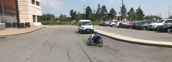 Curt Senf tests out his new trike in the Furnas parking lot outside Jarvis Hall on UB's North Campus.