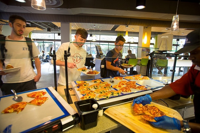 Students choose entrees at the C3