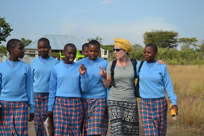 GEC Executive Director Anne Wadsworth with Kitenga students, learning about their day.