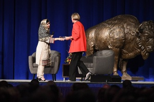 Malala Yousafzai shaking hands with engineering dean Liesl Folks