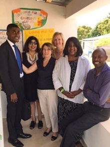 Posing with Haitian partners Jean Sampson Edourd (far left) and Elie La Fortune (far right) at a Haitian school are SUNY project members (from left) Filomena Critelli (UB), Laura Lewis (UB), Amy Nitza (New Paltz) and Kelly Patterson.