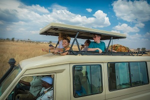 Student rode in a safari vehicle with a pop-up top while touring the Seregeti Natural Park.