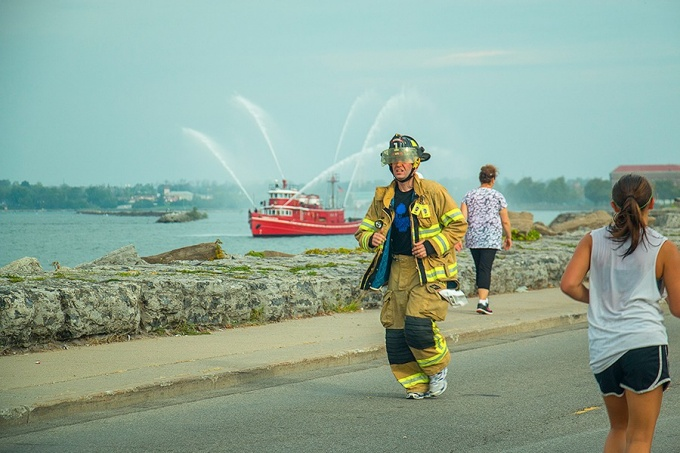 UB staff member Austin Byrd running last year's Tunnel to Towers 5K race in his firefighter gear.