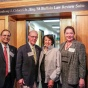 UB President Satish K. Tripathi, Anthony J. Colucci Jr., Carmela Colluci and UB School of Law Dean Aviva Abramovsky pose in from of the entrance to the Anthony J. Colucci Jr. Esq. '58 Buffalo Law Review Suite