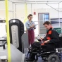 Man in wheelchair testing a securement system