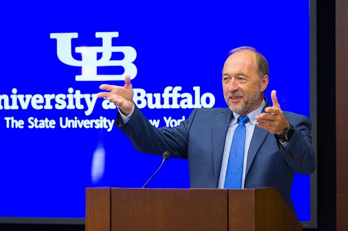 Stephen Still stands at a podium and gives remarks during a press conference announcing his gift of $4 million to the School of Engineering and Applied Sciences.