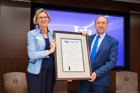 Liesl Folks (left) and Stephen Still hold a framed decree renaming the Institute for Sustainable Transportation and Logistics (ISTL) the Stephen Still Institute for Sustainable Transportation and Logistics.