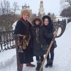 Molly Anderson (center) poses in frot of the Kremlin in Ryazan on a winter day.