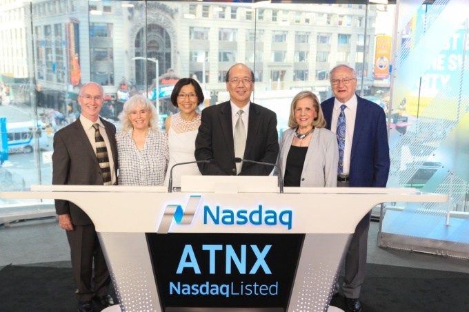 Athenex co-founders David Hangauer, Johnson Lau and Allen Barnett with their wives at the Nasdaq exchange.