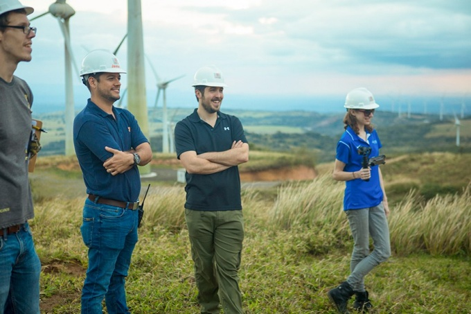 John Atkinson (third from left), during the recent trip to Costa Rica, stands near a wind turbine at a wind energy park he and his students toured.