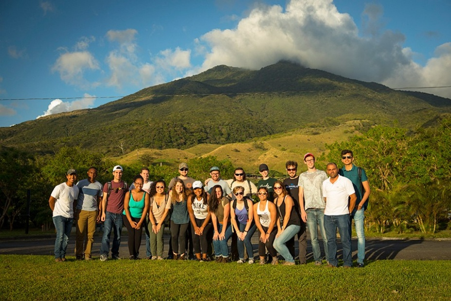 John Atkinson's study abroud class poses for a group photo at the foot of Miravalles volcano while visiting the Miravalles geothermal plant in Guanacaste, Costa Rica.