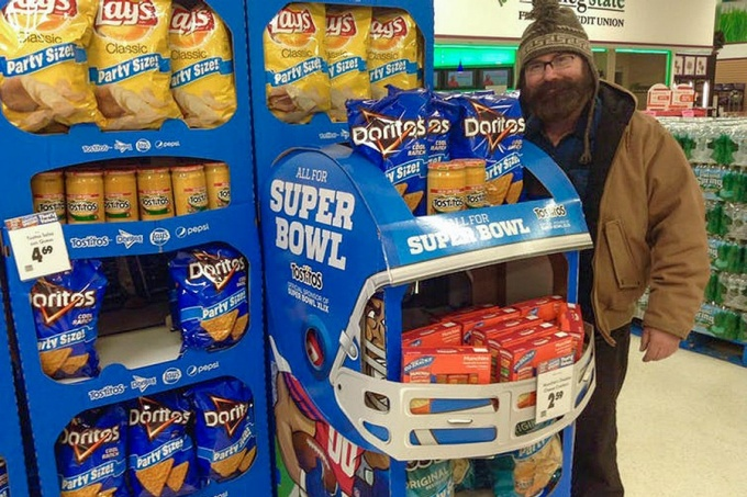 """Selfie"" of Mike Mozart standing next to an in-store Superbowl display for Doritos, cheese dip and potato chips. Image recognition engines can determine the preferred brands of users through the photos they post on social media."