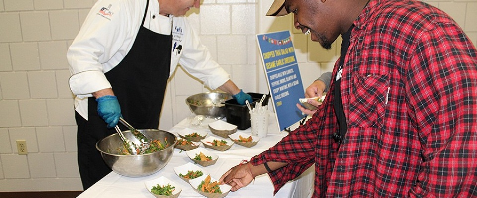 A student samples a dish that may be served at the international eatery as part of a focus group that took place in October 2017.
