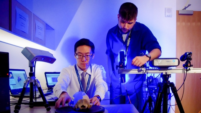 Jack Tseng and Anatomical Sciences master's student Connor Grabowski study a black bear skull using a high-resolution surface scanner.