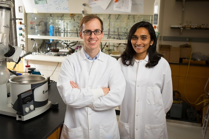 Chemistry professor Timothy Cook and PhD candidate Anjula Kosswattaarachchi in the lab