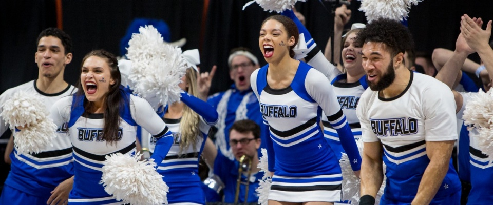 Photo of UB cheerleaders reacting with excitement at UB's NCAA Tournament game against Arizona.