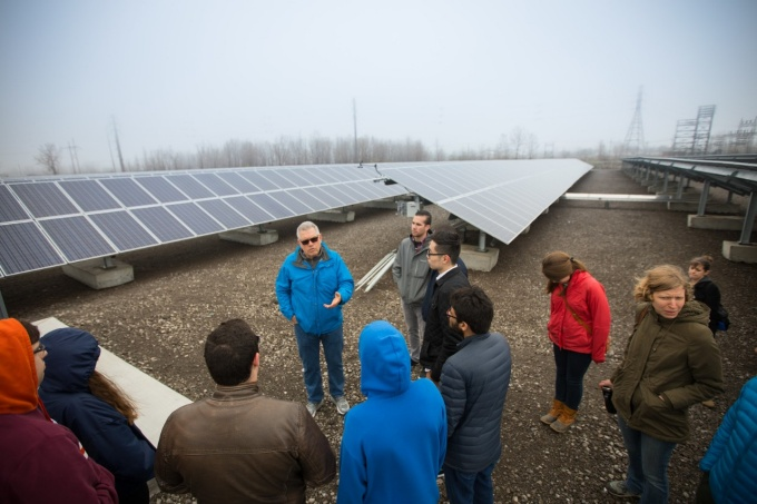 UB students stand near solar panels at the Steel Sun solar power plant in Lackawanna.