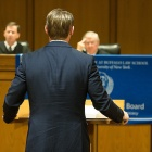 An advocate presents a case before an appellate panel of judges.