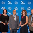 PSS award winners (from left) Erika Grande, Elizabeth Lidano, Rebecca Brierly and Peter Logiudice pose along with President Tripathi (center).