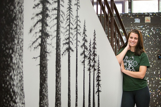 Britney-Bay Croyle poses next to the mural she created in Knox Hall.