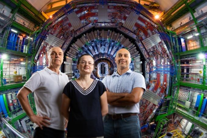 Photo illustration: Physicists Avto Kharchilava, Ia Iashvili and Salvatore Rappoccio appear to be standing in Large Hadron Collider