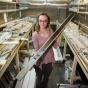 UB geologist Elizabeth Thomas holds a sediment core — a cylindrical sample of lakebed mud.