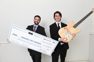 Algorhythm Technologies' co-founders Ryan Jaquin and Shane Nolan; Jaquin holds a big check for winning the Panasci competition; Nolan holds a guitar.